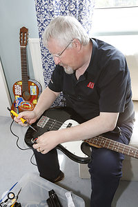 ...while Hugh Robjohns threatens an electric bass with a soldering iron.