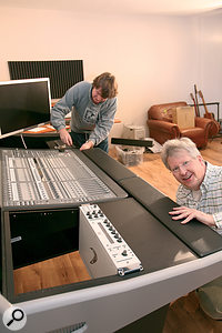 Paul and Hugh set about installing Kevin's flash new equipment in his flash new Argosy desk!