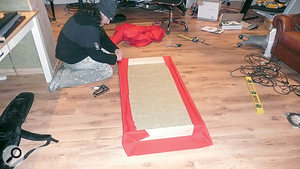 Kevin's friend Dean helps to construct some cost‑effective DIY acoustic panels.