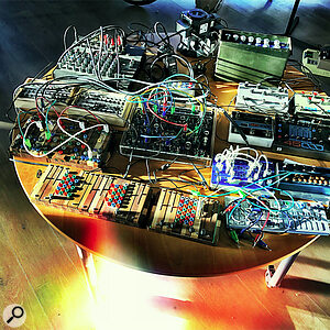 Robin Rimbaud's table of synth modules with Ciat-Lonbarde instruments at the front.