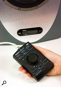 The main function of the remote is to provide volume control for the entire system (stereo, 2.1 or 5.1). It also enables users to access three configurable reference listening levels and four system presets.