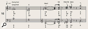 An extract from a contemporary arrangement by Tom Walsh, incorporating sustained chords and accented stabs.