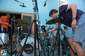 Hawley and van Limbeek put the finishing touches to a mic setup for a drum track.