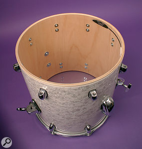 In this picture, you can see how the Ukko mic is attached to the inside of a drum. The inset shows the mic in more detail.