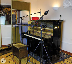 Here you can see the placement of the various mics at the front of the piano, with the DPA spaced stereo pair further back, just in shot, and then a  pair of AKG C414s and a  Royer stereo ribbon mic closer to the strings, along with a  single AKG D19 'Beatles mic' overhead.
