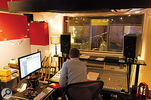 The author watches Marcel perform, as he auditions the different mic setups via the preamps in his Audient ASP8024 console.
