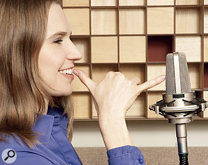Typically, you'd record with your mouth approximately the distance between your thumb and little finger from the mic, as pictured here.