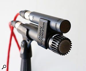 A clip to align an SM57 with a small-diaphragm condenser, in this case a Neumann KM184.