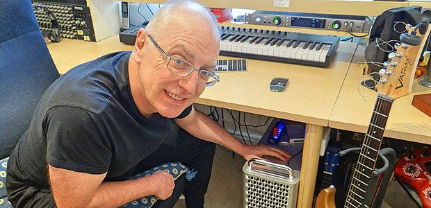 The article author Paul Baggott with Mac Pro below his studio desk