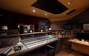 The Coach House control room is centered around a Neve 8128 console, accompanied by eight vintage Neve 1061 modules.